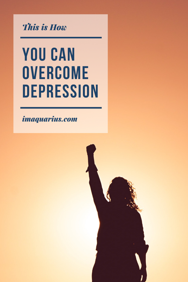 Lady with her fist in the air, triumphant because she has overcome depression