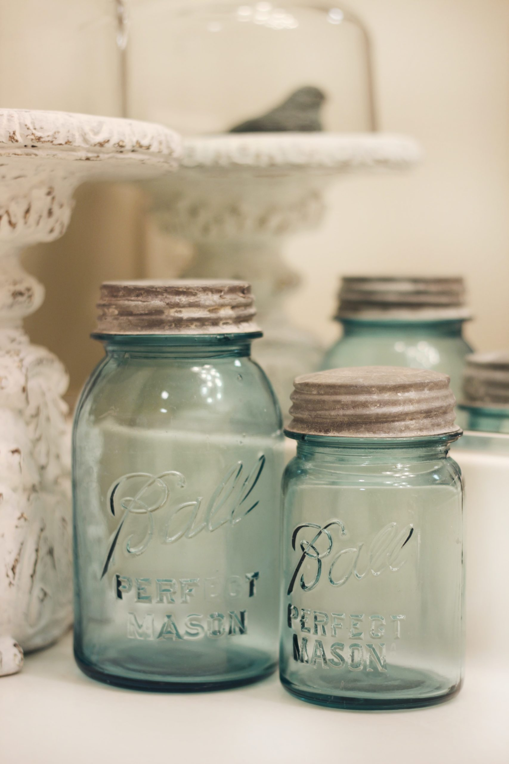 several empty canning jars in a decorative setting used for touch up painting