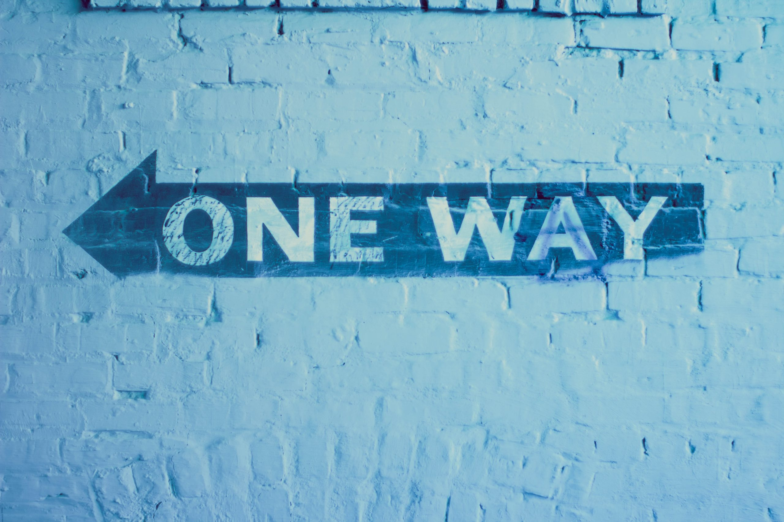 one way blue color code personality type sign written on a blue brick wall