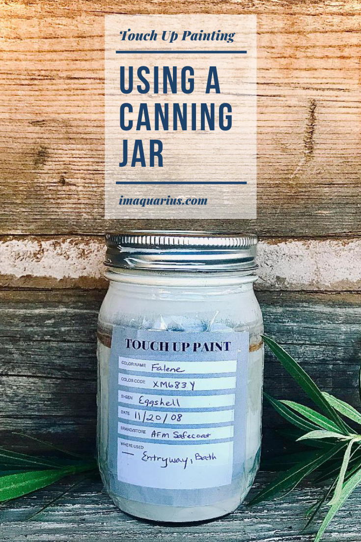 paint in a canning jar with a label in a rustic setting outdoors