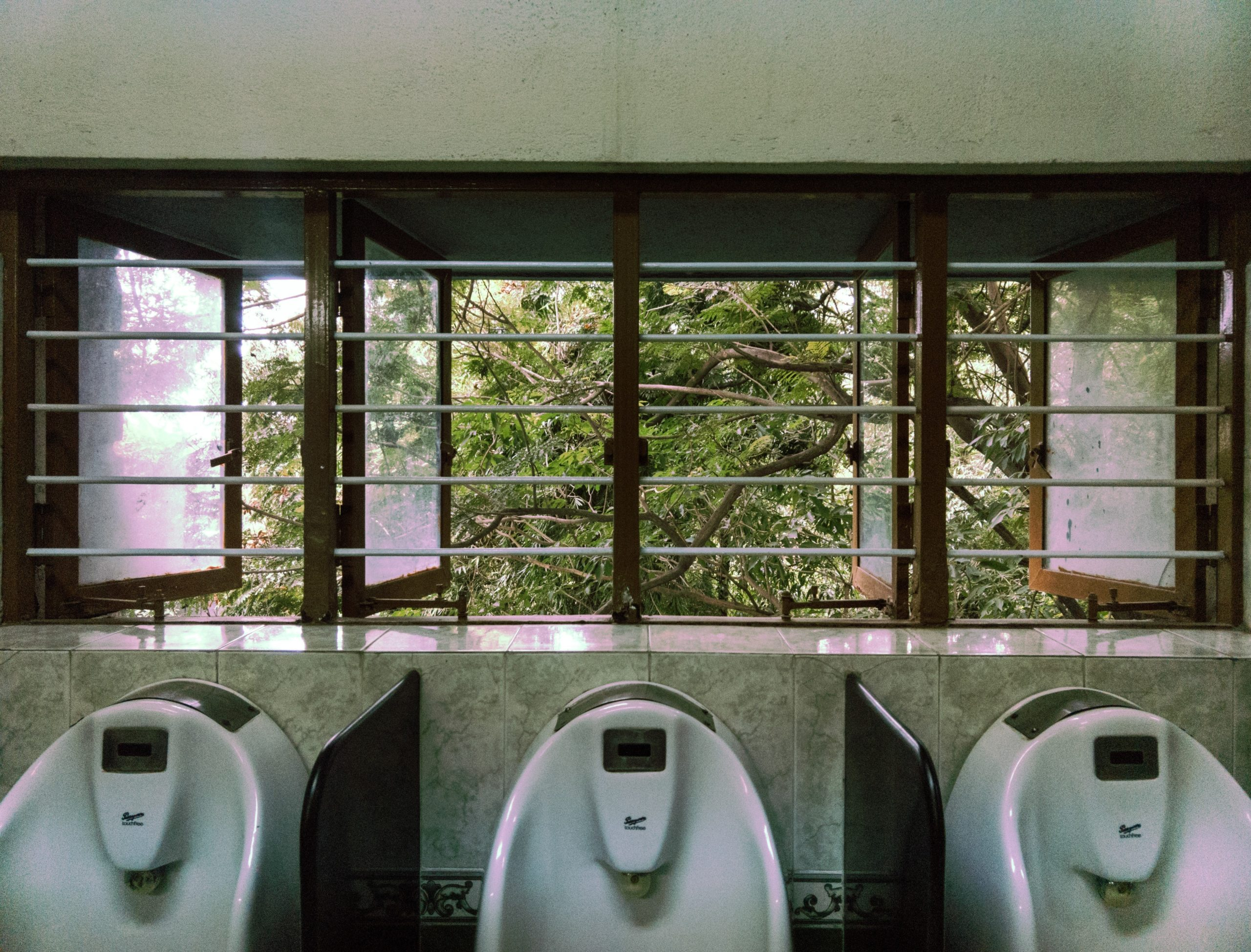clean-urinals-beneath-beatiful-window-for-a-better-cleaning-solution
