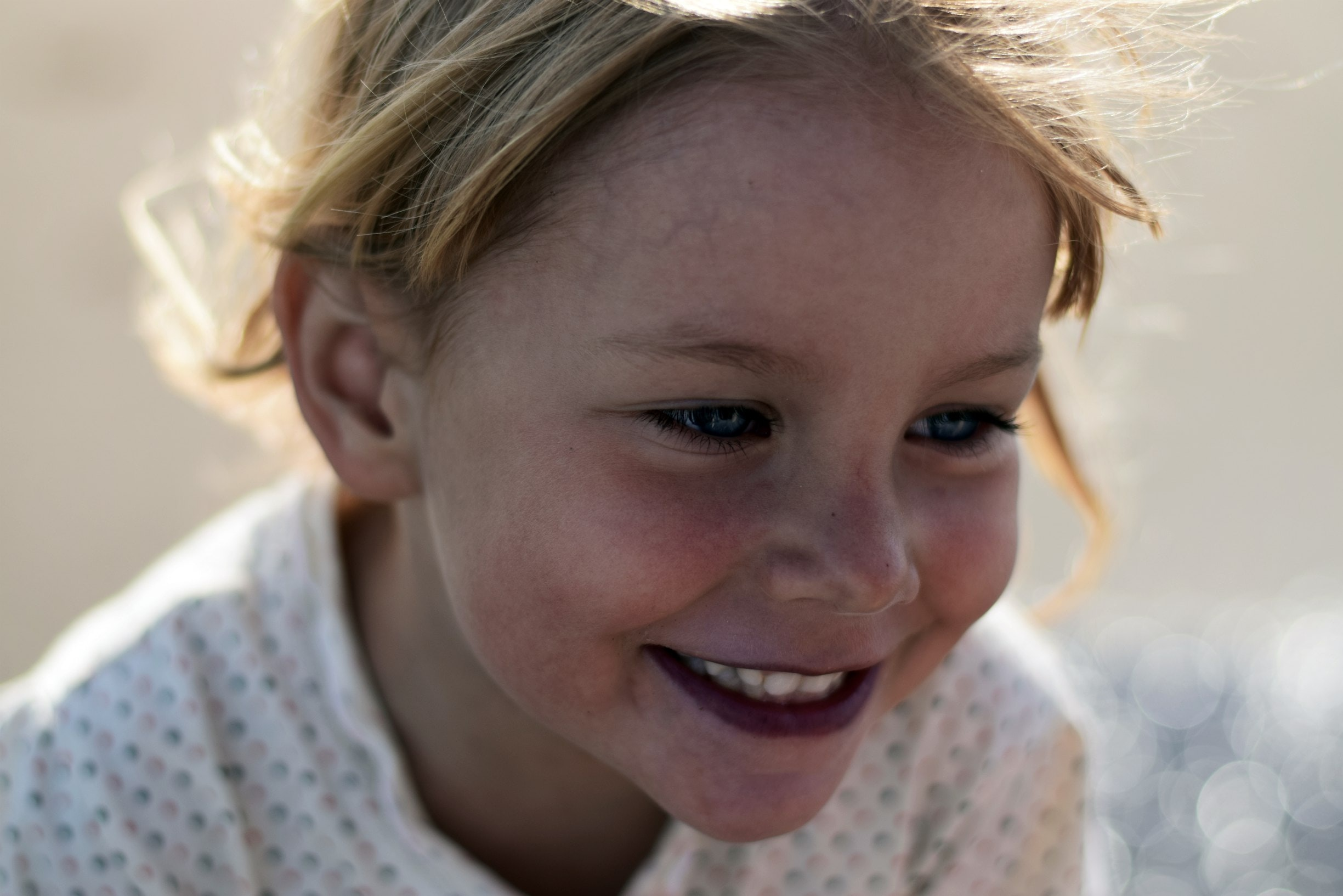 little girl smiling and showing that an obsessive compulsive cleaning solution can result in a happier life