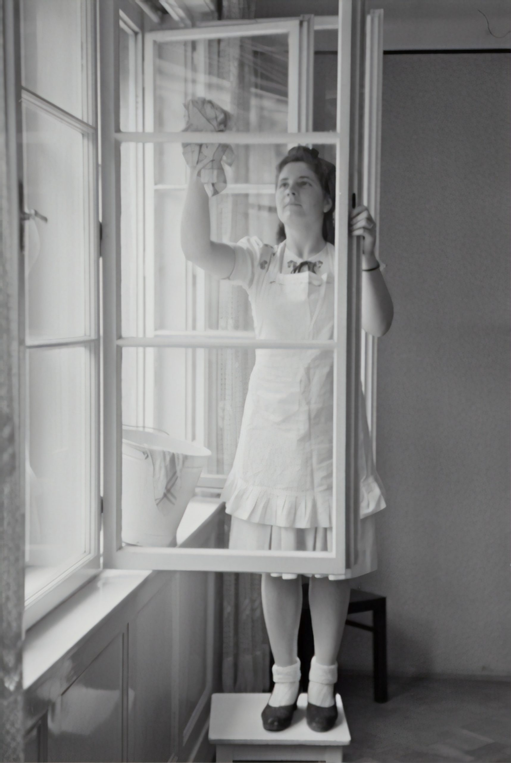 woman on a chair by a window using a better cleaning solution for an immaculate home